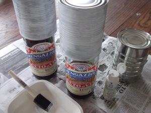 Shows cans upended onto bottles for ease of painting.