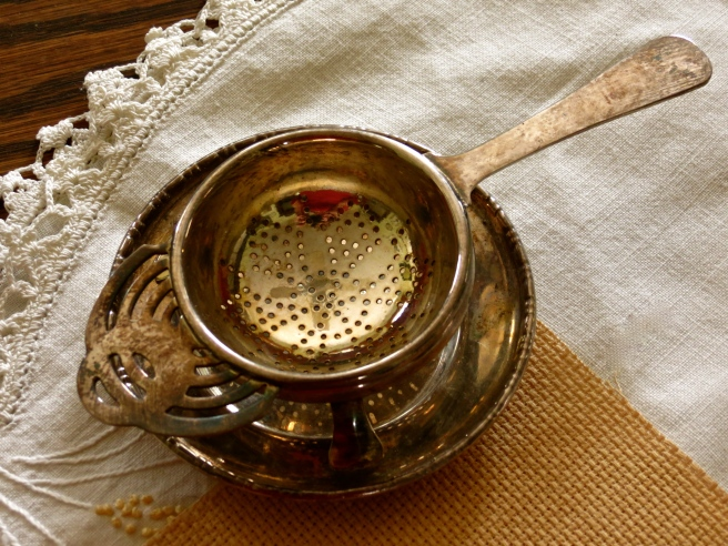 Tea strainer on its caddy.
