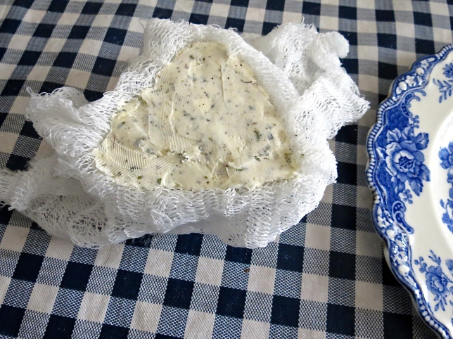 Herb cheese mixture packed into a ceramic mold.
