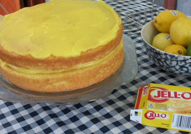 The lemon custard filling is spread on.