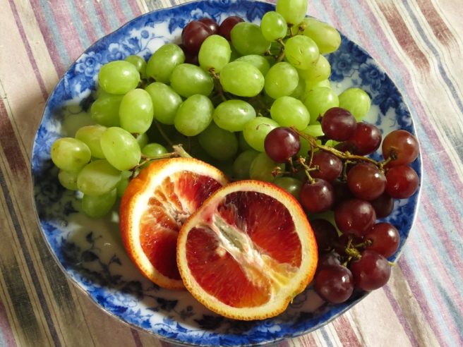 "The oranges are called ""blood oranges,"" and are available now in markets. The flavor is grape mixed with orange. Delicious!"